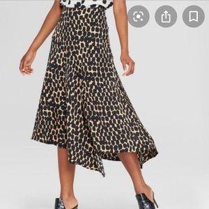 Asymmetrical leopard midi skirt